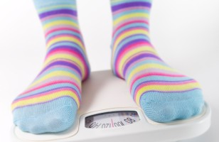 Woman Weighing Herself Wearing Cute Fun Girlie Socks