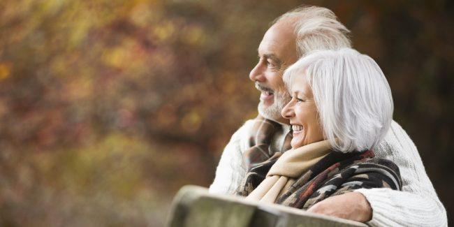 elderly-older-couple-on-park-bench-senior